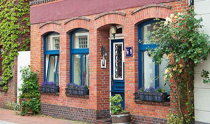 Brick house with blue window sash
